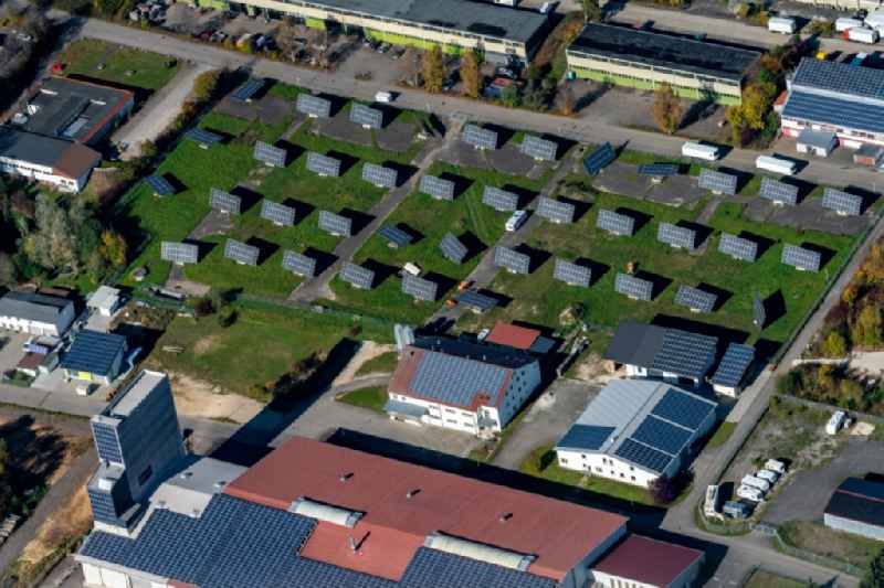 Panel rows of photovoltaic and solar farm or solar power plant in the commercial area in Engstingen in the state Baden-Wurttemberg, Germany