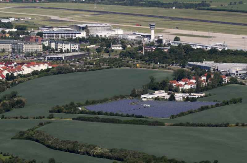 Panel rows of photovoltaic and solar farm or solar power plant on a field in the district Bindersleben in Erfurt in the state Thuringia, Germany