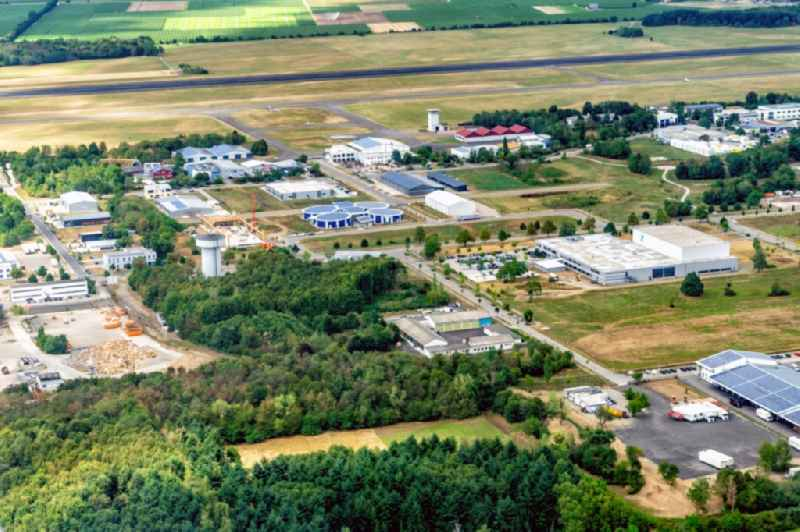 Breisgau Business Park in Eschbach in the state of Baden-Wuerttemberg and the runway of the airfield Bremgarten.