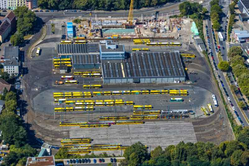 Tram depot of the Municipal Transport Company Ruhrbahn GmbH - Betriebshof Stadtmitte on Beuststrasse overlooking the construction site for the new building of an operating workshop in the district Ostviertel in Essen in the state North Rhine-Westphalia, Germany