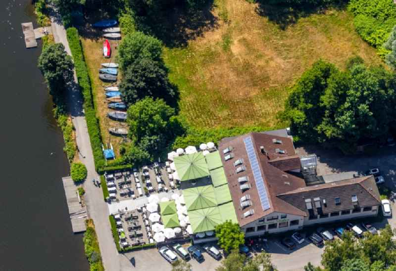 Tables and benches of open-air restaurants of 'Suedtiroler Stuben' on Freiherr-vom-Stein-Strasse in the district Bredeney in Essen in the state North Rhine-Westphalia, Germany