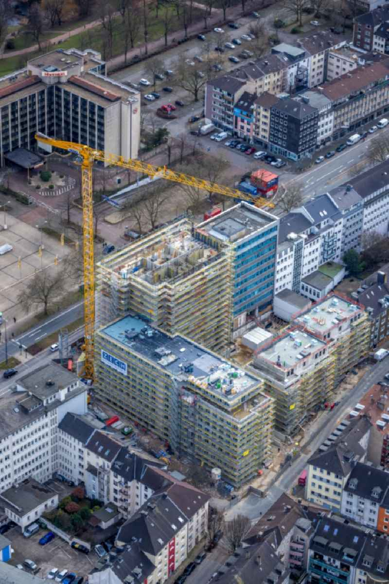 Construction site to build a new residential and commercial building 'HQE Huyssen Quartier Essen' with residential tower and senior citizens' apartments on Huyssenallee - corner of Heinrichstrasse in Essen in the Ruhr area in the state North Rhine-Westphalia, Germany