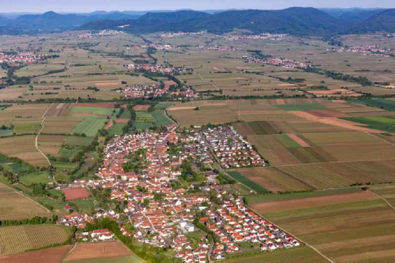 Village - view on the edge of agricultural fields and farmland in Essingen in the state Rhineland-Palatinate, Germany