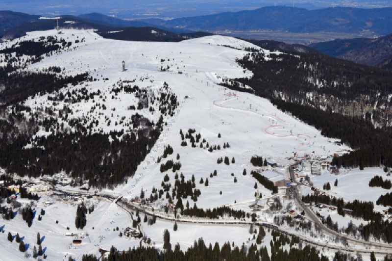 Wintry snowy mountainous landscape of the summit of Feldberg mountain with the ski sports area and parcour at the World Cup of Ski Cross in Feldberg (Schwarzwald) in the state Baden-Wurttemberg, Germany.