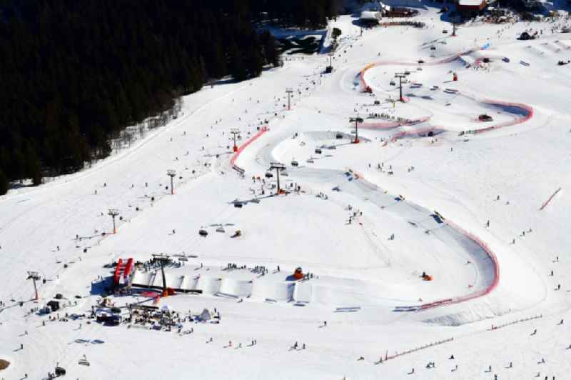 Wintry snowy landscape with the parcour for the World Cup Ski Cross at the ski sports area Seebuck on the Feldberg mountain in Feldberg (Schwarzwald) in the state Baden-Wurttemberg, Germany.