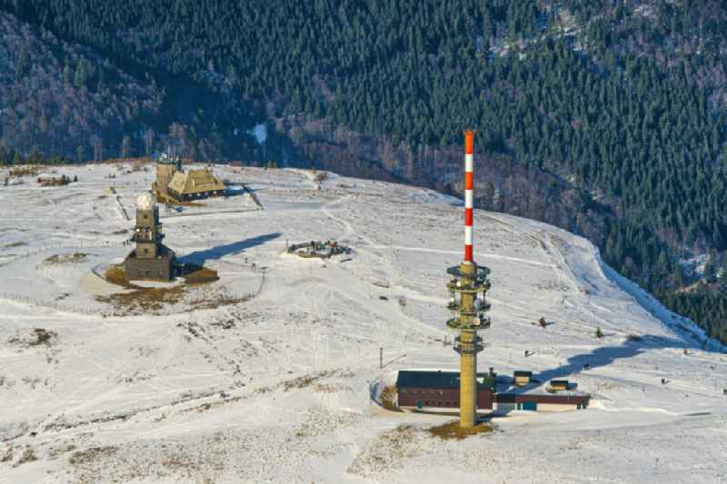 Wintry snowy landscape at the radio tower and transmitters on the crest of the mountain Feldberg (Schwarzwald) in the Black Forest in the state Baden-Wurttemberg. Clear view to the Swiss Alps