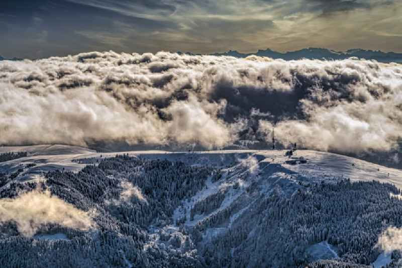 Wintry snowy weather conditions with cloud formation on Schwarzwald in Feldberg (Schwarzwald) in the state Baden-Wurttemberg, Germany