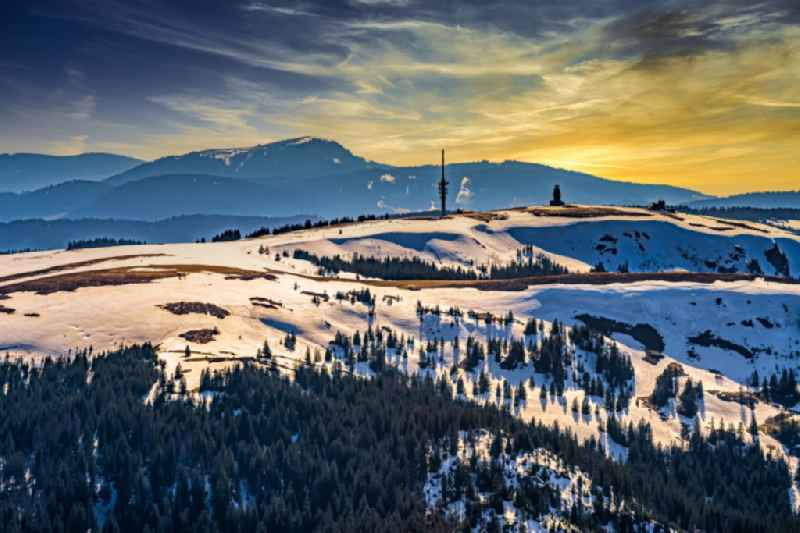 Wintry snowy crest of the mountain range Feldberg with the ACE-High NATO Troposcatter link station AFEZ ( Allied Command Europe ) in Feldberg (Schwarzwald) in the state Baden-Wurttemberg, Germany. The antennas were rebuildt in 1998