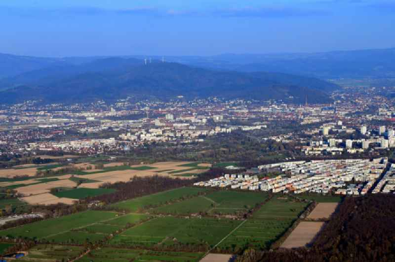 City area with outside districts Rieselfeld und Dietenbach in Freiburg im Breisgau in the state Baden-Wurttemberg, Germany. Looking to the mountains of the Black Forest.