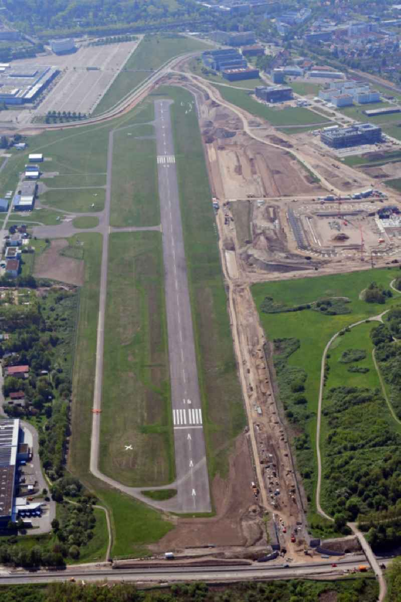 Runway of airfield EDTF in Freiburg im Breisgau in the state Baden-Wurttemberg, Germany. At the construction works area the new stadium of the SC Freiburg is built