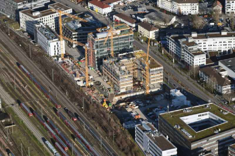 Construction site to build a new office and commercial building on Heinrich-von-Stephan-Strasse in Freiburg im Breisgau in the state Baden-Wurttemberg, Germany. Further information at: Autobahn GmbH,  JobRad GmbH,  STRABAG Real Estate GmbH.