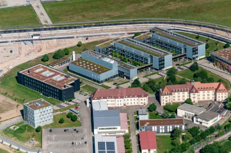 Research building and office complex of ' Albert-Ludwigs-Universitaet Freiburg ' on Georges-Koehler-Allee next to the construction works of the stadium for sports club Freiburg in Freiburg im Breisgau in the state Baden-Wurttemberg, Germany