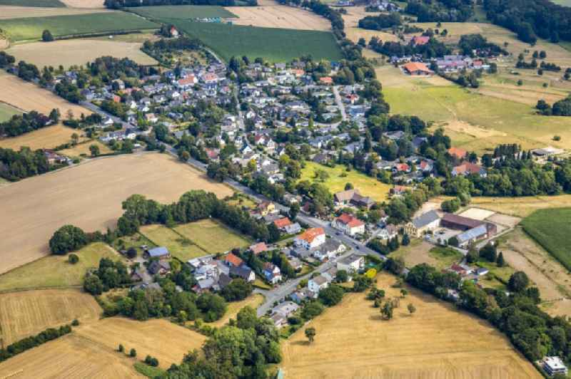 Village view on the edge of agricultural fields and land in the district Strickherdicke in Froendenberg/Ruhr in the state North Rhine-Westphalia, Germany