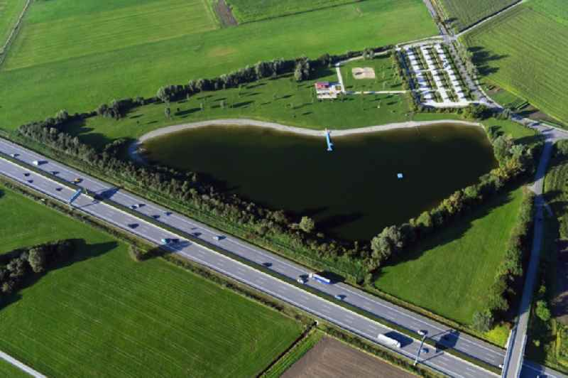 Riparian areas on the lake area of ' Eisolzrieder See ' on motorway A8 in Geiselbullach in the state Bavaria, Germany