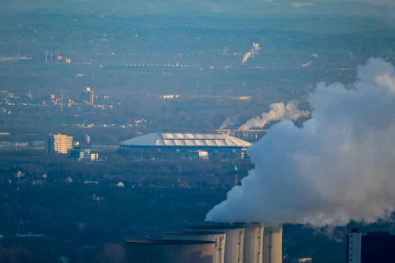 White exhaust smoke plumes from the power plants and exhaust towers of the coal-fired cogeneration plant in Gelsenkirchen in the state North Rhine-Westphalia, Germany.