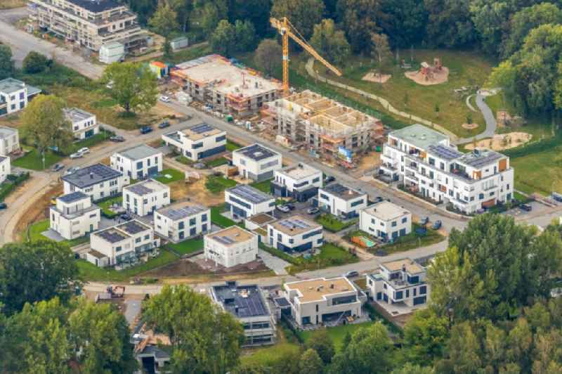 Residential area - mixed development of a multi-family housing estate and single-family housing estate of Wohnquartiers 'Am Buerschen Waldbogen' along the Westerholter Strasse - Im Waldquartier in Gelsenkirchen in the state North Rhine-Westphalia, Germany