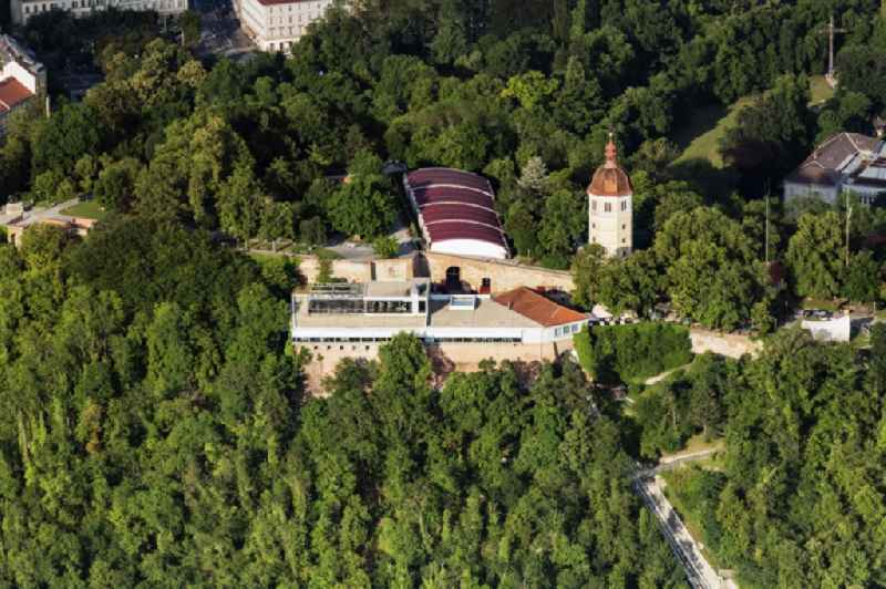 Construction of the building of the open-air theater Kasematten and of Glockenturm also called 'Liesl' genannt on Schlossberg in Graz in Steiermark, Austria.