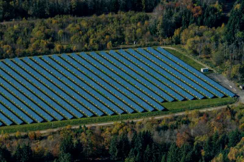Panel rows of photovoltaic and solar farm or solar power plant in Wald in Grossenstingen in the state Baden-Wurttemberg, Germany