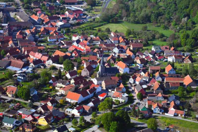 Location view of the streets and houses of residential areas in the valley landscape surrounded by mountains in Grossleinungen in the state Saxony-Anhalt, Germany