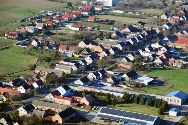 Agricultural land and field borders surround the settlement area of the village in Grosswoltersdorf in the state Brandenburg, Germany
