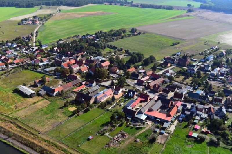 Village view on the edge of agricultural fields and land in Guesen in the state Saxony-Anhalt, Germany