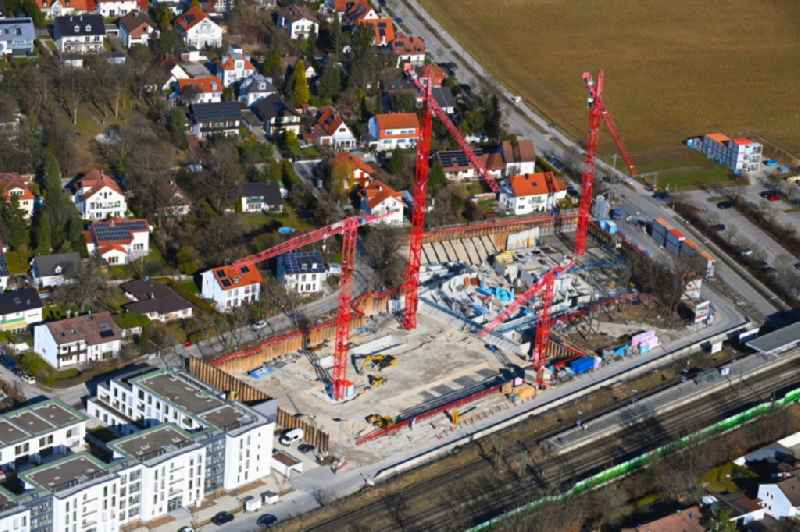 Construction site for the multi-family residential building on Heimgartenstrasse in the district Gronsdorf in Haar in the state Bavaria, Germany