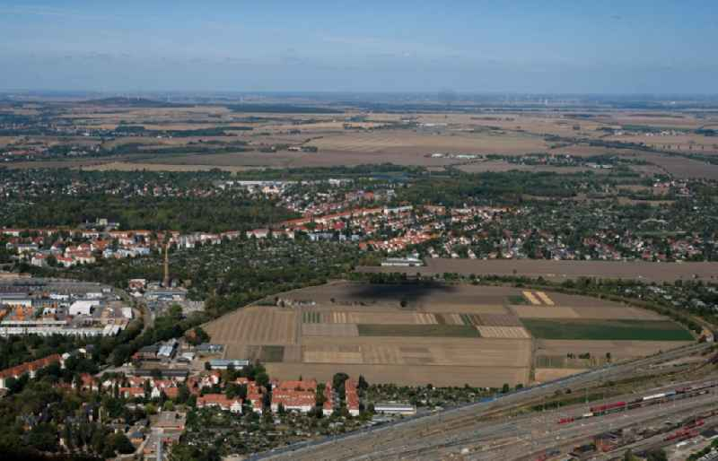 City view from the downtown area with the outskirts with adjacent agricultural fields overlooking the local railway line in the district Am Wasserturm - Thaerviertel in Halle (Saale) in the state Saxony-Anhalt, Germany.