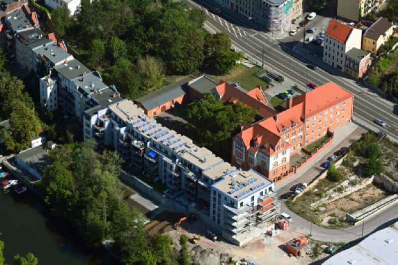Construction site for the new residential and commercial Corner house - building on the Weingaerten in the district Suedliche Innenstadt in Halle (Saale) in the state Saxony-Anhalt, Germany