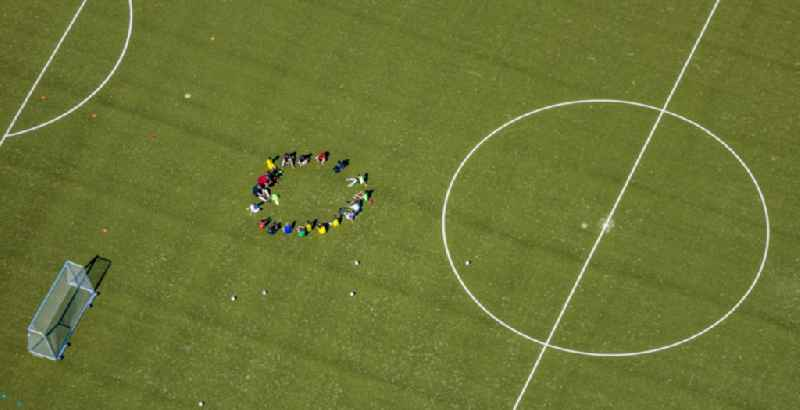 Sports grounds and football pitch with training players in Sportzentrum Ost in the district Heessen in Hamm in the state North Rhine-Westphalia, Germany