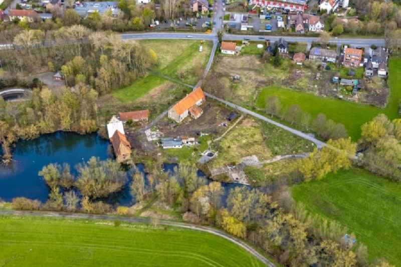 Castle mill on Muehlenteich pond in the Heessen part of Hamm at Ruhrgebiet in the state of North Rhine-Westphalia