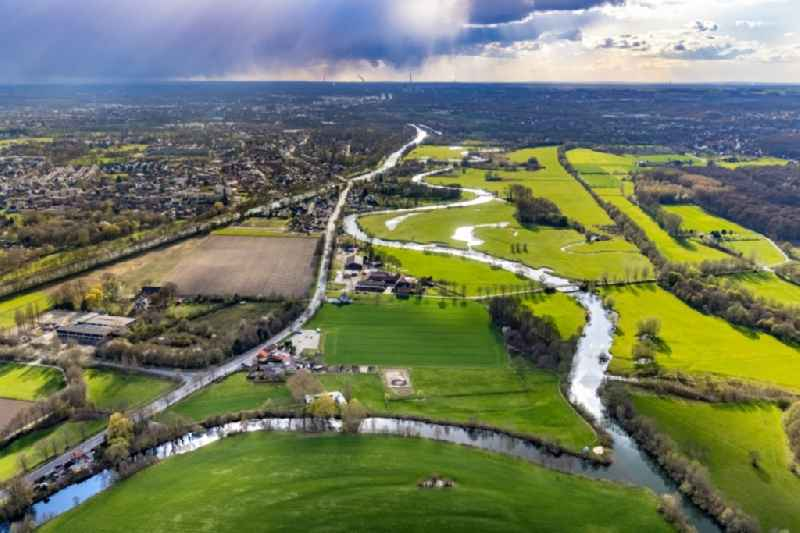 Meandering, serpentine curve of river Lippe in the field landscape along the Lippestrasse in the district Heessen in Hamm at Ruhrgebiet in the state North Rhine-Westphalia, Germany