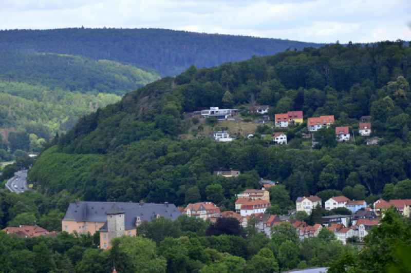 Location view of the streets and houses of residential areas in the valley landscape surrounded by mountains in Hann. Muenden in the state Lower Saxony, Germany.
