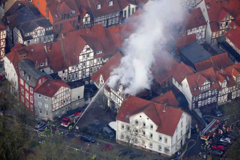 Extinguishing action of the fire brigade at the source of the fire and smoke formation in an apartment building Aegidiiplatz corner Wallstrasse in Hann. Muenden in the state Lower Saxony, Germany
