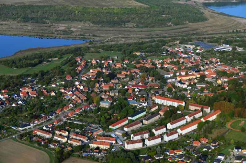 Agricultural land and field borders surround the settlement area of the village in Harbke in the state Saxony-Anhalt, Germany