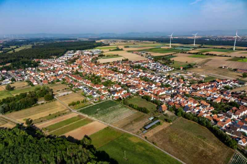 Village view on the edge of agricultural fields and land in Hatzenbuehl in the state Rhineland-Palatinate, Germany