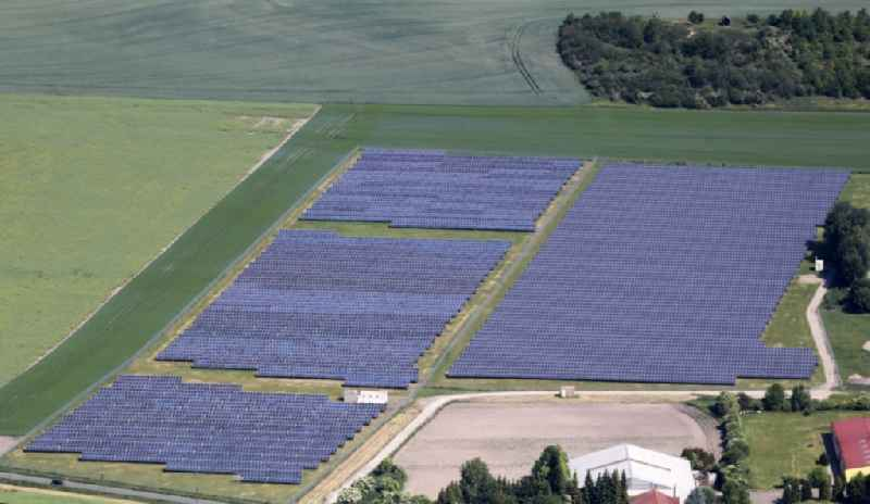 Panel rows of photovoltaic and solar farm or solar power plant in Herbsleben in the state Thuringia, Germany