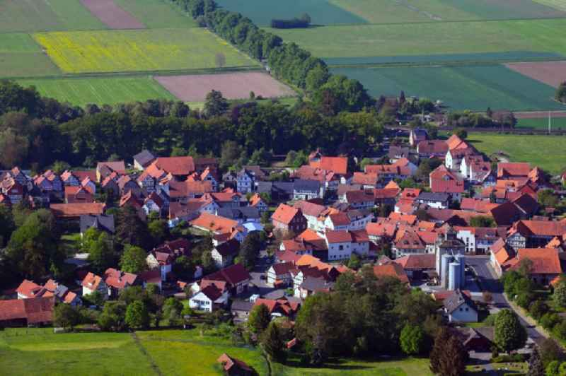 Village view on the edge of agricultural fields and land in Herleshausen in the state Hesse, Germany