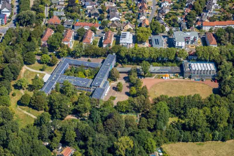 School building and sports field of 'Otto-Hahn-Gymnasium Herne' with renovation work on the swimming pool on Hoelkeskampring in Herne in the state North Rhine-Westphalia, Germany