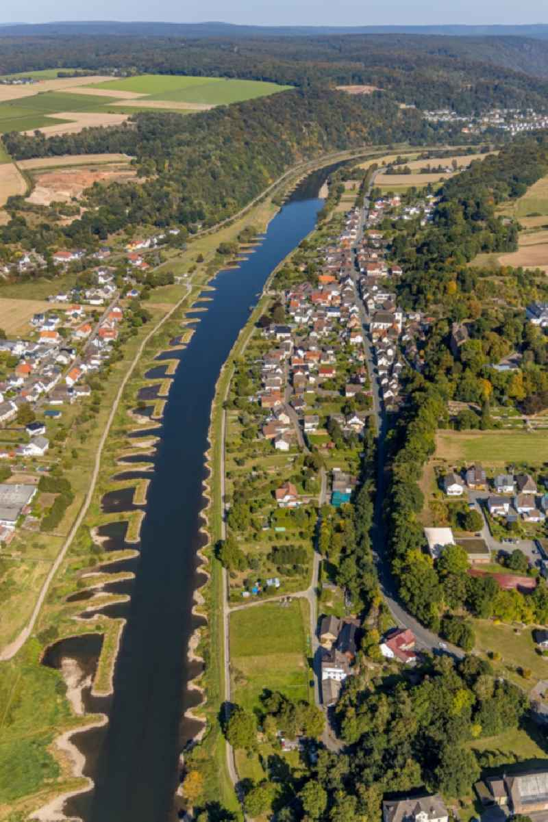Village on the banks of the area Weser - river course in Herstelle in the state North Rhine-Westphalia, Germany