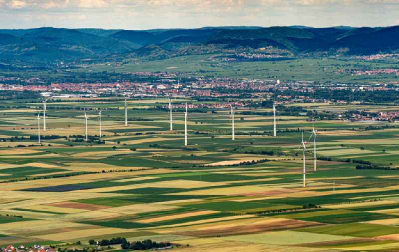 City view Uebersicht of Felof bai with silhouette of a group of wind power plants in Herxheimweyher in the state Rhineland-Palatinate, Germany