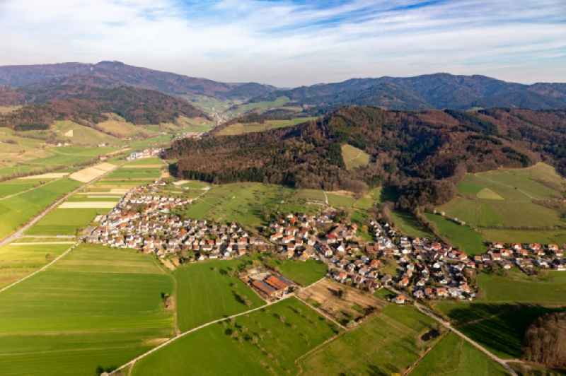 Agricultural land and field borders surround the settlement area of the village in Heuweiler in the state Baden-Wurttemberg, Germany