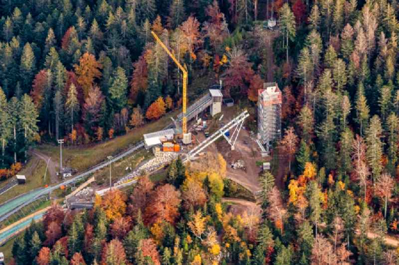 Autumnal discolored vegetation view training and competitive sports center of the ski jump Baustelle in Hinterzarten in the state Baden-Wuerttemberg, Germany