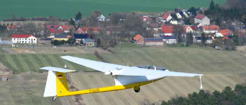 Glider and sport aircraft - Motorglider Ogar with the registration D-KOGE flying over the airspace in Hirschfelde in the state Brandenburg, Germany