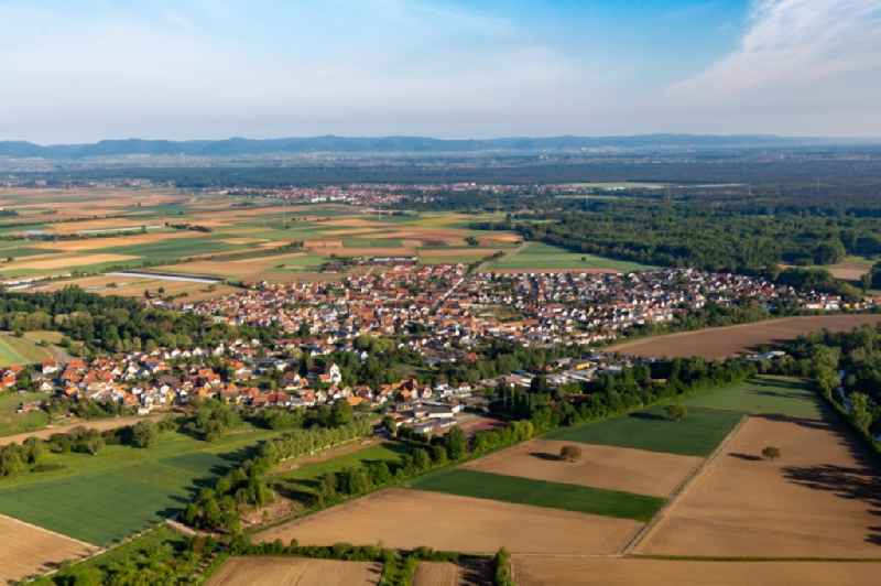 Village - view on the edge of agricultural fields and farmland in Hoerdt in the state Rhineland-Palatinate