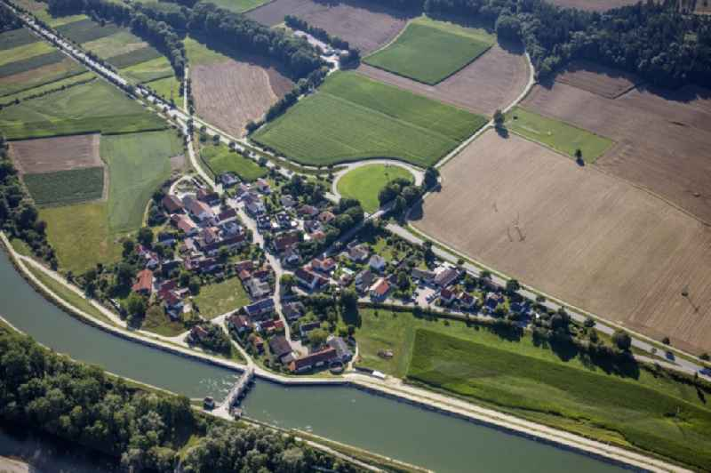 Village view on the banks of the Mittlere-Isar Canal and the Isar in Hofham in the state Bavaria, Germany