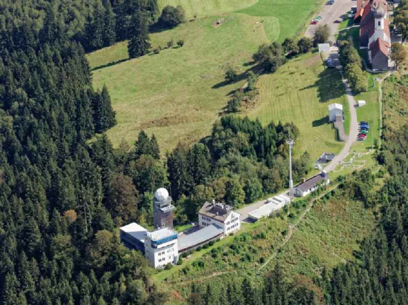 Summit of the Hohe Peissenberg near Hohenpeissenberg in the state of Bavaria. In the picture, the pilgrimage church of the Ascension of the Virgin Mary, Sendemast of the radio station and the meteorological observatory, the oldest mountain weather reserve in the world