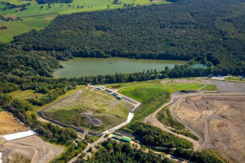 Renovation, sealing and restoration work on the site of the refurbished landfill overlooking a lake in Huenxe in the state North Rhine-Westphalia, Germany. Further information at: AGR Abfallentsorgungs-Gesellschaft Ruhrgebiet mbH.