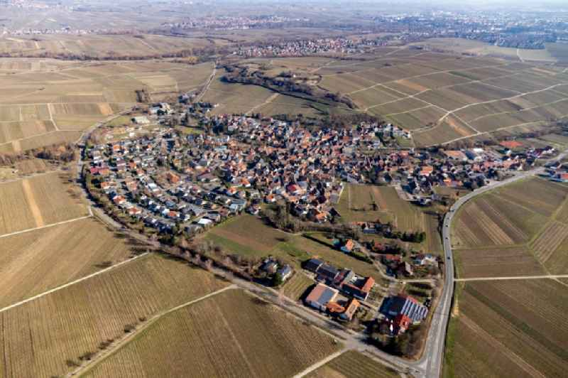 Agricultural land and field borders surround the settlement area of the village in Ilbesheim bei Landau in der Pfalz in the state Rhineland-Palatinate, Germany