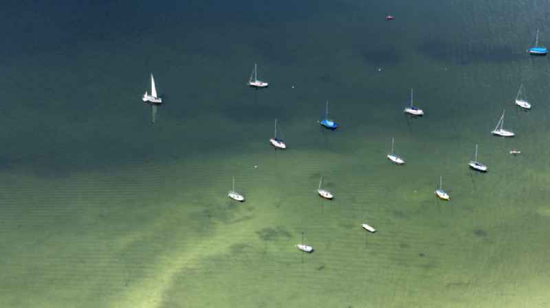 Sailboats in the harbor in Inning am Ammersee in the state Bavaria, Germany