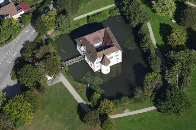 Building and castle park systems of moated castle Reichensteinwith restaurant and town hall in Inzlingen in the state Baden-Wurttemberg, Germany.